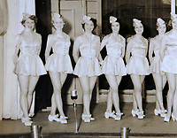 Pictured: Copy picture dated 1951, of the group of dancers Pat Stewart (2nd L) and Wendy Clarke (5th L) were dancing with in Blackpool, at the time when the iconic image by Bert Hardy was taken. Tuesday 01 March 2011<br /> Re: 77 year old Pat Stewart (nee Wilson) who now lives near Llantwit Major in the Vale of Glamorgan, south Wales claims she is one of the two young ladies in an iconic image taken by photographer Bert Hardy at Blackpool Promenade in July 1951, alongside fellow Tiller girl Wendy Clarke. Stewart is alleging that another woman, Norma Edmondson who has been claiming that it is her in the picture, is a fraud.