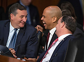 United States Senators Ted Cruz (Republican of Texas), left, Cory Booker (Democrat of New Jersey), center, and Mike Lee (Republican of Utah) share a light moment as they converse during the hearing on the nomination of Judge Brett Kavanaugh before the US Senate Judiciary Committee on his nomination as Associate Justice of the US Supreme Court to replace the retiring Justice Anthony Kennedy on Capitol Hill in Washington, DC on Friday, September 7, 2018.<br /> Credit: Ron Sachs / CNP