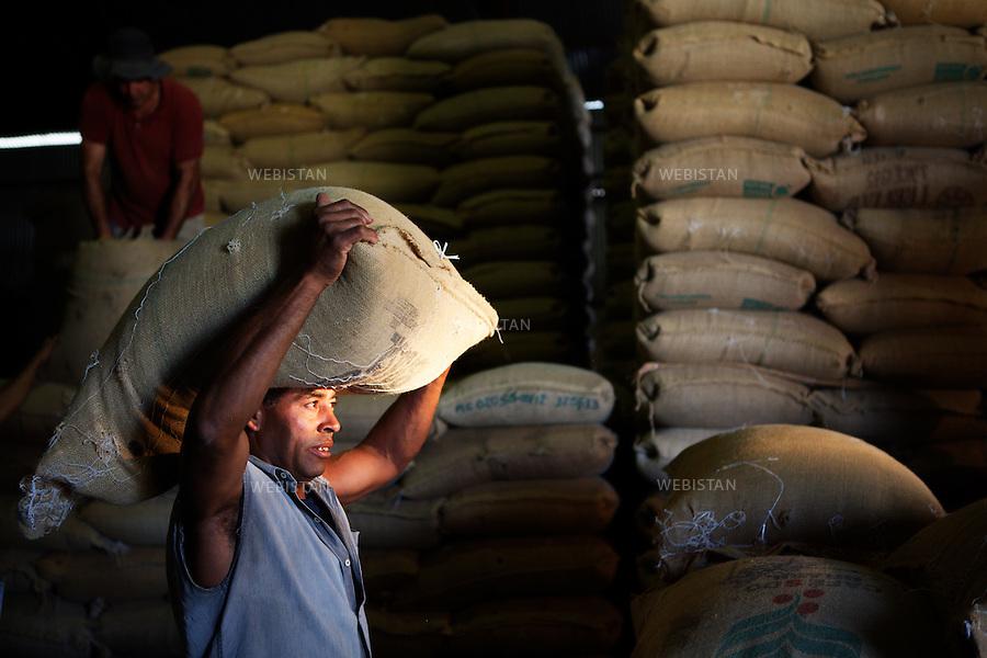 Bresil, etat Minas Gerais, Muzambinho (Nord de Sao Paulo), 30 octobre 2012.<br /> <br /> Societe Stockler, negociant-exportateur de cafe, partenaire de Nespresso dans le cadre du programme AAA.<br /> Entrepot Stockler&nbsp; : Mario Araujo et Geraldo Ferreira rangent les sacs de cafe livres par les producteurs.<br /> Reportage les Chants de cafe_soul of coffee, realise sur les acteurs terrain du programme de developpement durable Triple AAA de Nespresso.<br /> <br /> Brazil, Minas Gerais, Muzambinho, (North of Sao Paulo), October 30, 2012 <br /> <br /> Stockler, Commercial Coffee Exporter, Partner of Nespresso AAA Sustainable Quality Program.<br /> Stockler Warehouse: Mario Araujo and Geraldo Ferreira arrange the bags of coffee that were delivered by the producers. <br /> Assignment: les Chants de cafe_ Soul of Coffee, implemented on the fields of Nespresso&rsquo;s AAA Sustainable Quality Program.
