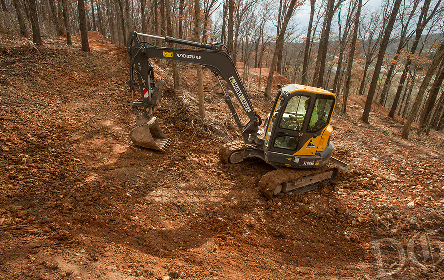 NWA Democrat-Gazette/BEN GOFF @NWABENGOFF<br /> Jeremy Witek with Rock Solid Trail Contracting builds a new downhill mountain bike trail Thursday, Jan. 10, 2019, at the Slaughter Pen trail system in Bentonville. The new line will be a hard-packed flow line Witek described as a 'dirt roller coaster' with sweeping banked turns and table top jumps. The crew is also re-working the existing downhill line into a more natural-surface and technical compliment to the new line.