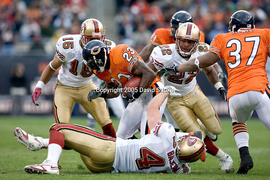 Jason McAddley #15, Terry Jackson #22 and Billy Bajema #47 of the San Francisco 49ers tackle Jerry Azumah #23 of the Chicago Bears on November 13, 2005 at Soldier Field in Chicago, Illinois. The Bears defeated the 49ers 17-9. (Photo by David Stluka)