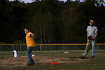 "Randy Joe Thomas, 43, and son Randy Jr., 13, practice pitching as the sun sets. ""God has made me rich with my family,"" said Thomas. Photo by Nikolas Kolenich"