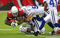 Sept. 27, 2009; Glendale, AZ, USA; Arizona Cardinals tackle (69) Mike Gandy gets tackled by Indianapolis Colts  linebacker (51) Jordan Senn at University of Phoenix Stadium. Indianapolis defeated Arizona 31-10. Mandatory Credit: Mark J. Rebilas-