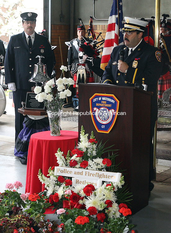 Waterbury, CT-09 May 2008-050908MK12 Director of Training Michael Couture reads the names of city firemen killed in the line of duty as Thomas Cassin tolls the Millennium Bell in Fire Station Ten during the seventeenth Annual Memorial Ceremony Friday morning.  The service held by the city's firefighters honored their coworkers who have died in the line of duty.  Captain John Keane's name, who died 5/22/07, was added to the list. Michael Kabelka Republican-American(Director of Training Michael Couture reads the names of city firemen killed in the line of duty as Thomas Cassin)CQ