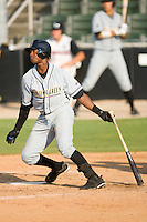 Tim Beckham #26 of the Bowling Green Hot Rods follows through on his swing versus the Kannapolis Intimidators at Fieldcrest Cannon Stadium August 23, 2009 in Kannapolis, North Carolina. (Photo by Brian Westerholt / Four Seam Images)