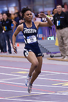 Latoya King crosses the finish line in first in the 60 meter finals.