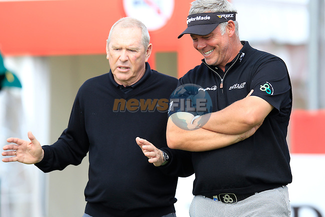 Darren Clarke (NIR) and Louis Martin, ISM, walk off the 1st tee during Wednesday's Practice Day of the Abu Dhabi HSBC Golf Championship at Abu Dhabi Golf Club, 16th January 2013 (Photo Eoin Clarke/www.golffile.ie)