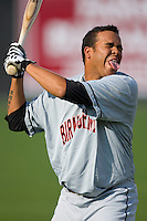 Clevelan Santeliz #47 of the Birmingham Barons jokes with his teammates at Five County Stadium August 15, 2009 in Zebulon, North Carolina. (Photo by Brian Westerholt / Four Seam Images)