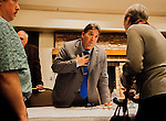 Assemblymember Jim Frazier (Ca-11) speaks to people from the audience after the public meeting with Restore the Delta about the proposed Delta Tunnel plan at the Lone Tree Golf & Event Center in Antioch, California on Thursday, March 6th, 2014. Photo/ Victoria Sheridan