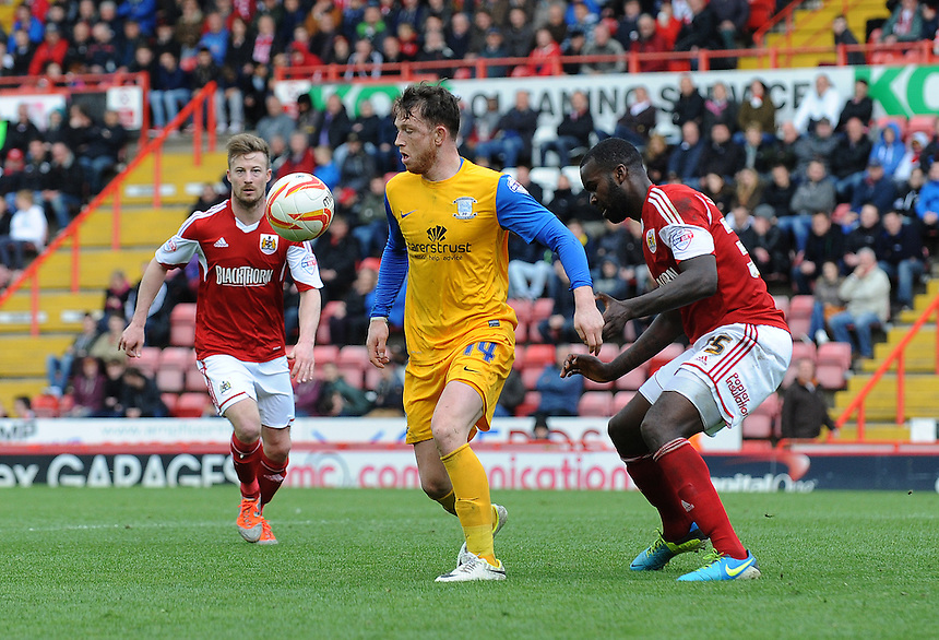Preston North End's Joe Garner shields the ball from Bristol City's Karleigh Osborne<br /> <br /> Photo by Ian Cook/CameraSport<br /> <br /> Football - The Football League Sky Bet League One - Bristol City v Preston North End - Saturday 5th April 2014 - Ashton Gate - Bristol<br /> <br /> &copy; CameraSport - 43 Linden Ave. Countesthorpe. Leicester. England. LE8 5PG - Tel: +44 (0) 116 277 4147 - admin@camerasport.com - www.camerasport.com