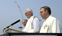 Mons Dan o'Riordan, Bishop Darling and Rev Warren  blessing  the Jeanie Johnston on Sunday..Picture by Don MacMonagle