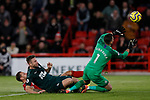 Martin Dubravka (r) of Newcastle United saves a shot by Billy Sharp of Sheffield United during the Premier League match at Bramall Lane, Sheffield. Picture date: 5th December 2019. Picture credit should read: James Wilson/Sportimage