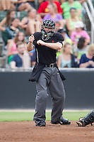 Home plate umpire Robert Waterhouse makes a strike call during the South Atlantic League game between the Charleston RiverDogs and the Kannapolis Intimidators at CMC-NorthEast Stadium on June 28, 2014 in Kannapolis, North Carolina.  The Intimidators defeated the RiverDogs 4-3. (Brian Westerholt/Four Seam Images)