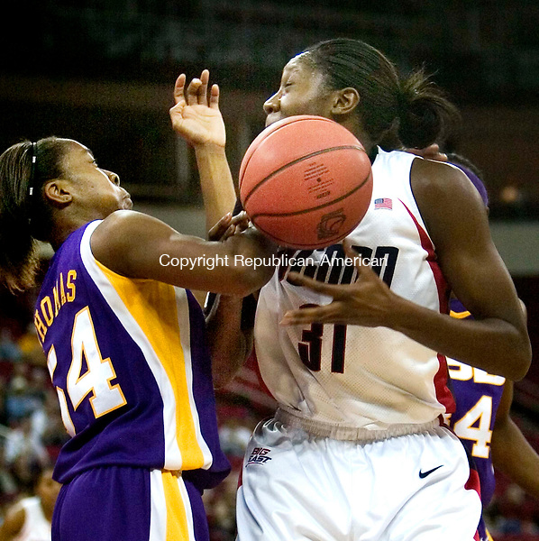 FRESNO, CA. 26 March 2007-032607SV02--#31 Tina Charles of UConn get stripped of the ball by   54 Ashley Thomas of LSU during the elite eight round of the NCAA tournament at the Save Mart Center in Fresno, CA. Monday.<br /> Steven Valenti Republican-American