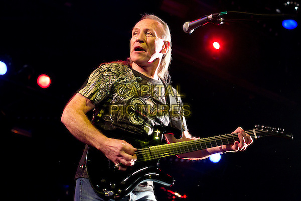 Mark Farner .In concert in Club Milk. Moscow, Russia..December 8th, 2011.on stage live gig performance performing music half length black t-shirt guitar mouth open.CAP/PER/SB.©SB/PersonaStars/CapitalPictures