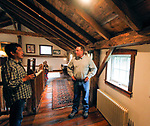 """ROXBURY, CT - 15 OCTOBER 2017 -101517JW05.jpg -- Ed Cady talks about the wood beams that he used to create his home with HGTV's """"You Live in What?"""" producer Kent Takano Sunday morning. Jonathan Wilcox Republican-American"""