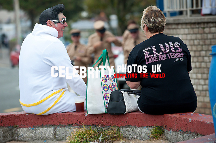 Tens of thousands Elvis Presley fans descend on the small Welsh seaside town of Porthcawl in South Wales for a three day celebration of all things Elvis and listen to Elvis tribute artists at the largest festival of its kind in Europe. Porthcawl, Glamorgan, Wales, UK. 26th September, 2014. Photo: SnapDragon