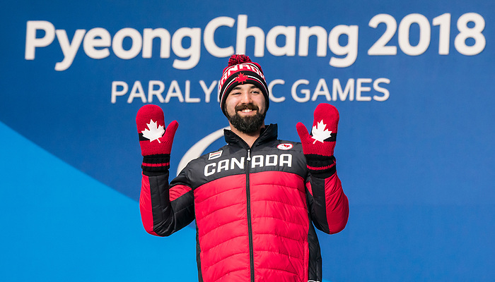 PyeongChang 16/3/2018 - Collin Cameron collects his bronze medal in the men's biathlon 12.5km sitting during the medal ceremony at the PyeongChang Medals Plaza during the 2018 Winter Paralympic Games in Pyeongchang, Korea. Photo: Dave Holland/Canadian Paralympic Committee