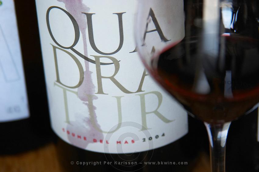 Cuvee Quadratur. Domaine Coume del Mas. Banyuls-sur-Mer. Roussillon. France. Europe. Bottle. Wine glass.