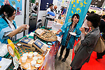 Exhibitors offer samples of their products to a visitor during the 41st International Food and Beverage Exhibition (FOODEX JAPAN 2016) on March 8, 2016, Chiba, Japan. 3,000 exhibitors from 78 nations are showcasing their products in Asia's largest food and beverage trade show held at Makuhari Messe. This year organisers expect 75,000 visitors during the four day show from March 8 to 11. (Photo by Rodrigo Reyes Marin/AFLO)