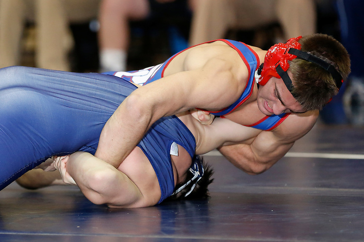 At the 138 pound weight class, Spring Grove's Mike Hartman runs an arm bar on West York's Cole Rinehart, pinning him. (For the Daily Record/Sunday News -- Shane Keller)