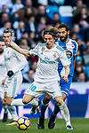 Luka Modric (L) of Real Madrid in action during the La Liga 2017-18 match between Real Madrid and RC Deportivo La Coruna at Santiago Bernabeu Stadium on January 21 2018 in Madrid, Spain. Photo by Diego Gonzalez / Power Sport Images