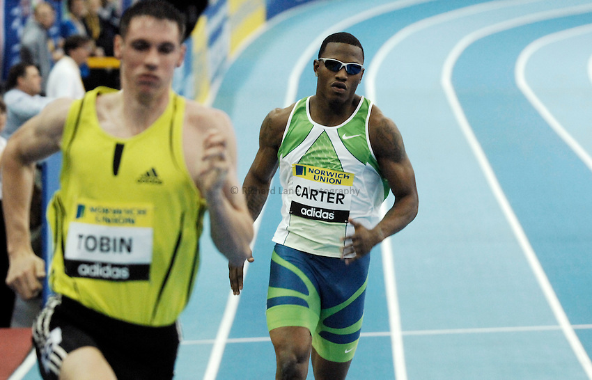 Photo: Richard Lane..Norwich Union Indoor Grand Prix, Birmingham. 17/02/2007. .USA's  Xavier Carter on his way to winning the men's 400m chases Great Britain's Robert Tobin. He is later disqualified for stepping out of his lane early and Tobin wins.