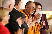 The Dalai Lama acknowledges applause during a Congressional Gold Medal ceremony in his honor in the US Capitol in Washington DC USA on 17 October 2007.
