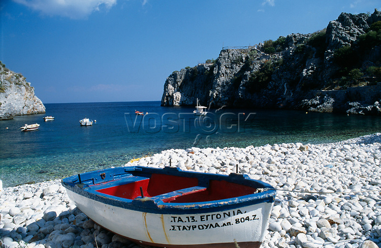 Boat on white pebble beach