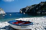 Boat on white pebble beach