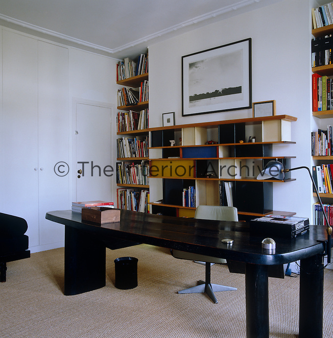In the study-cum-library books filll two alcoves and are also displayed on the Jean Prouve bookcase positioned inbetween