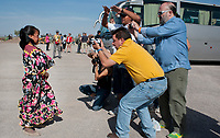 A Tarahumara indian girl being photographed by toursuts in a Menonite community, Ciudad Cuahutemoc, Chihuahua, Mexico. Aromas y Sabores with Chef Patricia Quintana