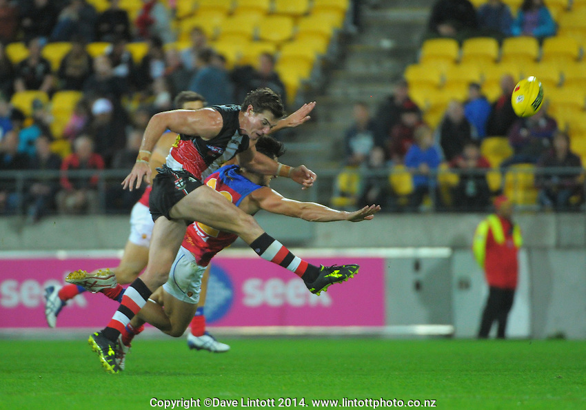 Lenny Hayes kicks for goal during the Australian Rules Football ANZAC Day match between St Kilda Saints and Brisbane Lions at Westpac Stadium, Wellington, New Zealand on Friday, 25 April 2014. Photo: Dave Lintott / lintottphoto.co.nz