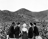 Marilyn Monroe sings several songs for an estimated 13,000 men of the First Marine Division.  Miss Monroe stopped by at the First Marine Regiment on her tour of the military units in Korea.  February 16, 1954.  Cpl. Kreplin.  (Marine Corps)<br /> NARA FILE #  127-N-A365478<br /> WAR &amp; CONFLICT BOOK #:  1467