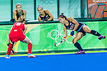 Melissa Gonzalez #5 of United States passes during Great Britain vs USA in a women's Pool B game at the Rio 2016 Olympics at the Olympic Hockey Centre in Rio de Janeiro, Brazil.