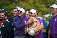 24.09.2014. Gleneagles, Auchterarder, Perthshire, Scotland.  The Ryder Cup.  Ian Poulter, Justin Rose, Sergio Garcia (EUR) pose with Jura a 16 week Scottish Police puppy during their practice round.