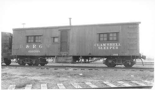 Clam shell standard gauge sleeper at Grand Junction.<br /> D&amp;RGW  Grand Junction, CO  Taken by Darrell, Paul - 8/1939