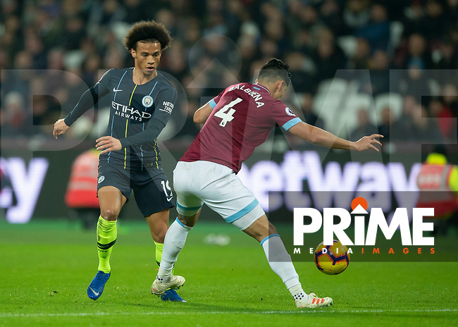 Leroy Sané of Manchester City goes past Fabián Balbuena of West Ham United during the Premier League match between West Ham United and Manchester City at the Olympic Park, London, England on 24 November 2018. Photo by Vince Mignott / PRiME Media Images.