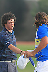 Dubai World Championship Golf. Earth Course,.Jumeirah Golf Estate, Dubai, U.A.E...A very tired looking Rory McIlroy shakes hands with Johan Edfors  on the 18th after the second round of the Dubai World Golf championship..Photo: Fran Caffrey/www.golffile.ie...