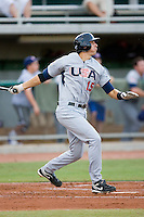 Jason Castro #15 of Team USA follows through on his swing versus Team Canada at the USA Baseball National Training Center, September 4, 2009 in Cary, North Carolina.  (Photo by Brian Westerholt / Four Seam Images)