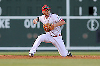 Boston Red Sox shortstop Stephen Drew (7) grabs a ground ball and throws out a runner for the Class A Greenville Drive on a tuneup assignment in a game against the Augusta GreenJackets on Friday, May 23, 2014, at Fluor Field at the West End in Greenville, South Carolina. (Tom Priddy/Four Seam Images)