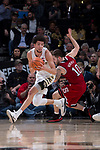 Donovan Mitchell (2) of the Wake Forest Demon Deacons controls the ball in front of Braxton Beverly (10) during second half action at the LJVM Coliseum on February 17, 2018 in Winston-Salem, North Carolina.  The Wolfpack defeated the Demon Deacons 90-84.  (Brian Westerholt/Sports On Film)