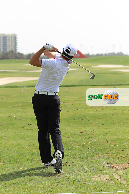 Alejandro Canizares (ESP) on the range at the Abu Dhabi HSBC Golf Championship 2013.Picture: Fran Caffrey / www.golffile.ie ..