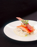 SINGAPORE, Asia, close-up of a pan seared ocean trout served in a plate at the Sentosa Resort Restaurant.