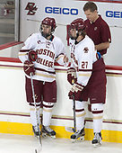 Matthew Gaudreau (BC - 21), Graham McPhee (BC - 27), Bert Lenz (BC - Director-Sports Medicine) - The visiting University of Vermont Catamounts tied the Boston College Eagles 2-2 on Saturday, February 18, 2017, Boston College's senior night at Kelley Rink in Conte Forum in Chestnut Hill, Massachusetts.Vermont and BC tied 2-2 on Saturday, February 18, 2017, Boston College's senior night at Kelley Rink in Conte Forum in Chestnut Hill, Massachusetts.