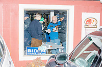 Attendees register as they arrive at a campaign event for Democratic presidential candidate and former Vice President Joe Biden at The Sports Barn in Hampton, New Hampshire, on Sun., December 8, 2019.