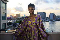 LAGOS, NIGERIA – DECEMBER 4: Favour Lucky, winner of Nigeria's Next Super Model 2012, waits backstage between shows during the Africa International Fashion Week in the Lagos Oriental Hotel, Nigeria 2014<br /> (Photo by: Per-Anders Pettersson)
