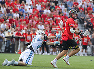 Baltimore, MD - April 28, 2018: Maryland Terrapins Bubba Fairman (2) gets pushed by Johns Hopkins Blue Jays Christopher Hubler (26) during game between John Hopkins and Maryland at  Homewood Field in Baltimore, MD.  (Photo by Elliott Brown/Media Images International)