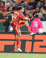Dwayne De Rosario #14 of Toronto FC pulls in a high ball during an MLS match against D.C. United that was the final appearance of D.C. United's Jaime Moreno at RFK Stadium, in Washington D.C. on October 23, 2010. Toronto won 3-2.