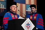 George M. Pearce, Class of 1979, left, reads the alumni induction with Corey Celt, student speaker, at the DePaul University College of Law commencement ceremony, Sunday, May 14, 2017, at the Rosemont Theatre in Rosemont, IL, where some 240 students received their Juris Doctors or Master of Laws degrees. (DePaul University/Jeff Carrion)